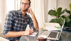 Home office environment for this young writer - stock photo
