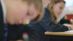 4K Young students working at their desks in school classroom. Stock Footage