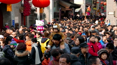 Crowds in Chinese spring festival temple fair Stock Footage