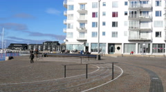 Passing a nice square at the seaside on my way to the cafe Stock Footage