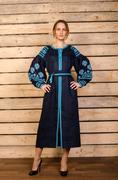 Stock Photo of Ukrainian embroidered female folk costume  background wood