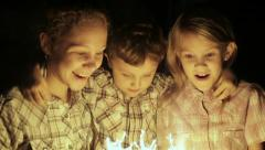 Happy kids standing on the road and burning sparkles at the night time. - stock footage