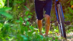 Legs and Feet of Cyclist Pushing Mountain Bike Uphill. Video 1920x1080 Stock Footage