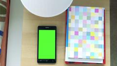 Smartphone on bedside table - phone green screen  Stock Footage