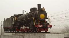 Old Locomotive on a pedestal in the fog Steadicam Shot  - stock footage