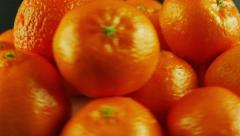 Macro Shot of Rotating Tangerines - Black Background - stock footage