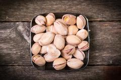 Mix nuts on wooden table,healthy vegan food. Stock Photos