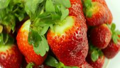 Top-down View of Rotating Strawberries on White Background - stock footage
