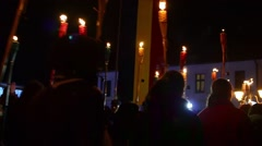 Column of children marching on a street with lit torches to commemorate Stock Footage