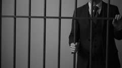 A white collar corporate tax evader in prison - stock footage