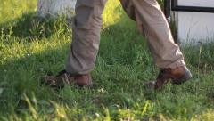 Man goes on a grass alley, into a park or cemetery - stock footage