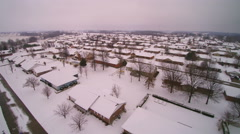 Pan left to right of neighborhood and school just after snow Stock Footage