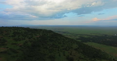 Aerial panorama view over Masai Mara camping in mountains landscape - stock footage