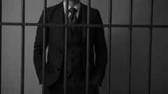 A rich criminal behind bars in prison - stock footage