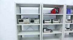 Stock Video Footage of Shelf With Oscilloscopes in Lab Tech Laboratory Engineering