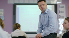 4K Young students listening to the teacher in school lesson Stock Footage