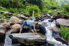 Woman doing Ashtanga Vinyasa yoga asana  outdoors - stock photo