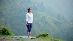 Woman doing yoga asana tree pose outdoors Stock Footage
