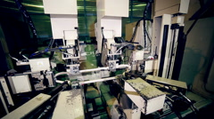 Robotic machine making hi-tech equipment on the industrial factory Stock Footage