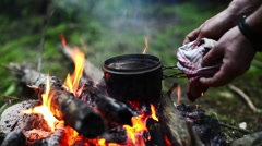 Coffee is boiling on the campfire. Stock Footage