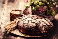 Fresh bread on wooden table ,vintage filter - stock photo
