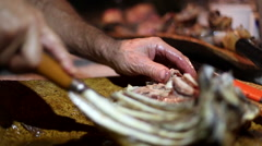 Closeup of carving ribs of roasted meat in Sardinia, Italy. - stock footage