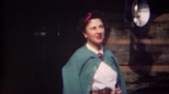 1943: Women in 40's style green cardigan sweater button at neck. Stock Footage