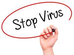 Man Hand writing Stop Virus with black marker on visual screen Kuvituskuvat