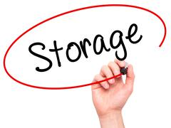 Man Hand writing Storage with black marker on visual screen Stock Photos