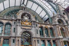 Main hall with clock of art deco station of Antwerp, Belgium - stock photo