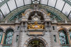 Main hall with clock of art deco station of Antwerp, Belgium Stock Photos