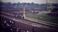 1948: Horse has big lead at racing track on wet muddy day. Stock Footage