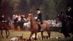 1944: Fox hunting equestrian horse riding expo trotting around track. Stock Footage