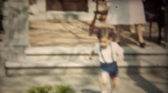 1942: Toddler boy running in blue suspenders from home porch closeup. Stock Footage