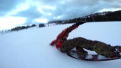 Snowboarder slides on the snow slope Stock Footage