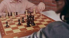 Children playing chess. Slider shoot. Close up Stock Footage