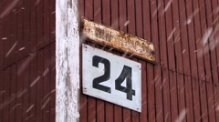 Street and house number sign at the wall of a building in Barentsburg, Norway. Stock Footage