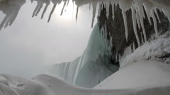 Icicles Under the Frozen Falls with Sound Stock Footage