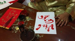 Calligraphers writing calligraphy with Tet Viet holiday - stock footage