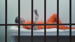 Scene of an inmate in a jail or prison Stock Footage