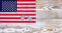 USA Flag and military ID tags on fade white wood background - stock photo