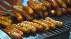 Ew sausages cooking on a wood barbecue Stock Footage