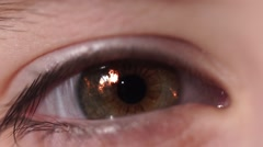 Fiery Flash in Children's Eye. An Eye Blinks and Changes Color to the Blue. - stock footage