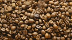 Pouring coffee beans. Stock Footage