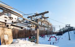 "Chairlift in ""Krasnaya Glinka"" mountain ski resort in winter - stock photo"