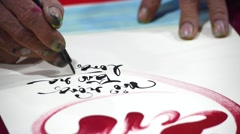 Calligraphers writing calligraphy with Tet Viet holiday Stock Footage
