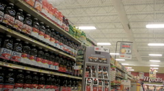Moving through the juice, coffee and tea aisles of a large grocery store - stock footage
