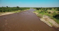 Aerial view flying over river. Kenya. Africa. Travel tourism from bird eye view. Stock Footage