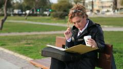 Business woman reading documents outdoors Stock Footage