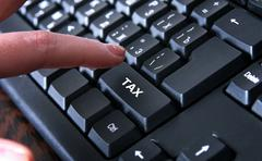 tax return on the keyboard - stock photo